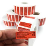 orange custom labels on rolls